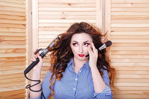 Girl with curling irons and brush