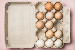Natural colored eggs for Easter in box, copy space