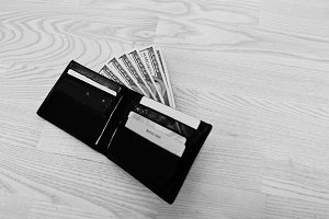 Dollars in the black leather wallet
