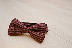 bow tie on light wooden background