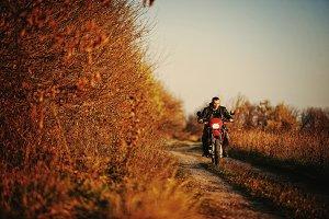 Motorcycle rider with enduro bike