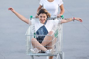 Laughing women riding in trolley on