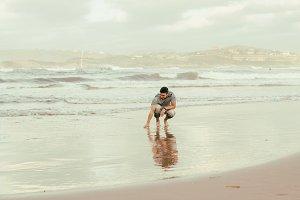 Young man enjoying the beach