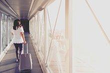 Woman on a boarding bridge