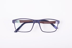 Blue eye glasses on white background. Isolated.
