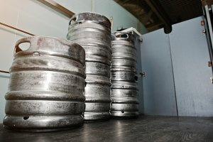 Three metal beer keg barrel