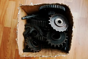 Old metal cog wheels together in box