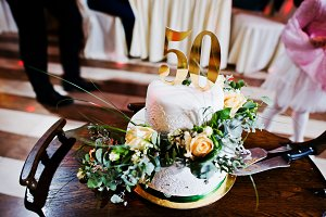 Cake anniversary in 50 at table