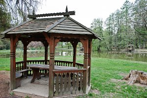 Wooden garden house pavilion at park