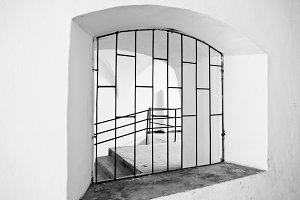 Arched window with metal grating
