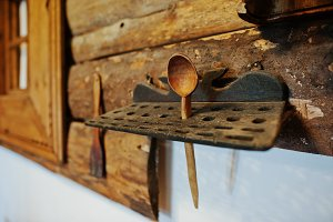 Old wooden spoon on a stand
