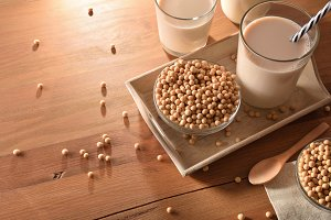 Soy milk and grains on wood table