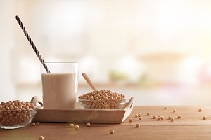 Soy milk and grains in white kitchen