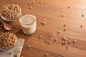 Soy milk and grains on table top