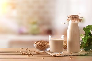 Soy milk in rustic kitchen front