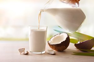 Filling a glass with coconut milk