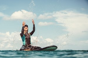 Girl in the ocean on surfboard