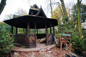 wooden summerhouse at autumn yard