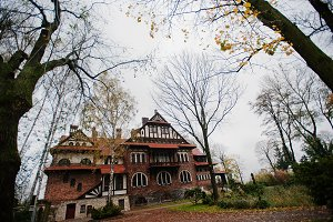 Old abandoned brick  mystic mansion.