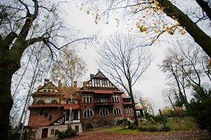 Old abandoned brick  mystic mansion.