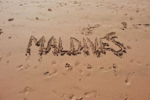 """Maldives"" written in the sand"