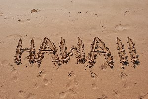 """Hawaii"" written in the sand"