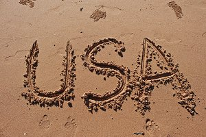 """USA"" written in the sand"