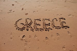 """Greece"" written in the sand"