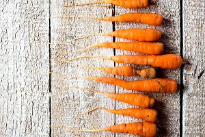 Fresh carrot vegetable laid on white wooden table