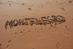 """Montenegro"" written in the sand"