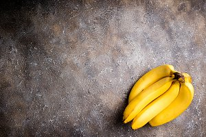 Bananas on concrete background