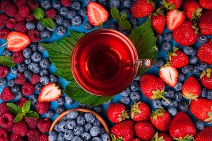 Cup of herbal tea with berries mix