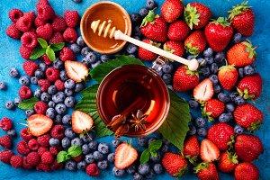 Cup of herbal tea with berries