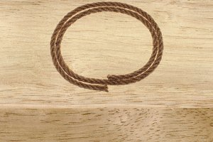 rope frame on wood background