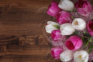 tulip bouquet on wood background