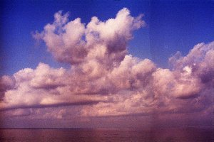 Clouds over sea35mm film scan. Atta