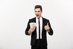 Business Concept - Successful Businessman holding dollar bills and showing thumb up isolated over white background.
