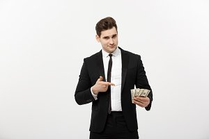 Business Concept: Handsome Businessman in suit pointing finger to money. Isolated on white background.