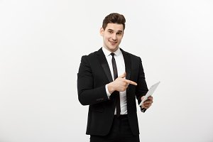 Business Concept: Happy smiling businessman pointing on digital tablet on white background