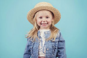 happy and smiling baby with hat
