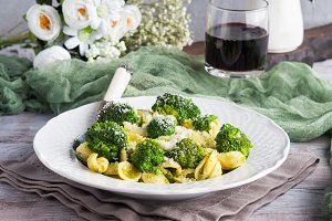 Orecchiette pasta with broccoli in white dish