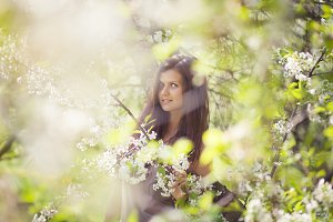 attractive girl in a flowering