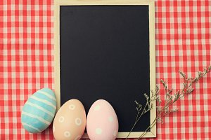 easter eggs on blank blackboard