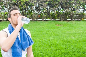 man drinking water after exercise pr
