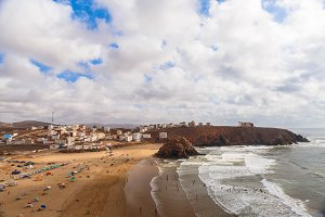 Breathtaking view on Atlantic ocean beach in small Morrocan town Iguer Ouzrou