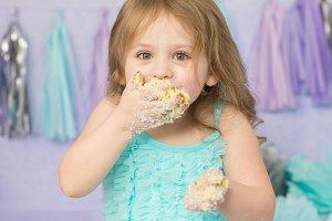 Little Girl Smashing Cake on Face