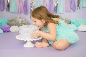 Little Girl Smashing Birthday Cake