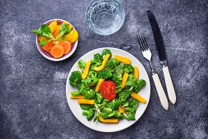 Healthy vegetable salad and glass of water