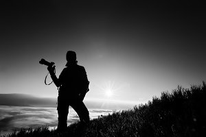 Silhouette of man photographer