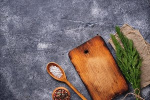 Culinary background with spices and cutting board